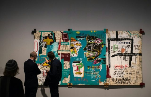 """US artist Jean Michel Basquiat, a pioneer of the street artist scene which is enjoying a sales boom, is the subject of a new exhibition """"Basquiat: Boom for real"""" at the Barbican in London"""