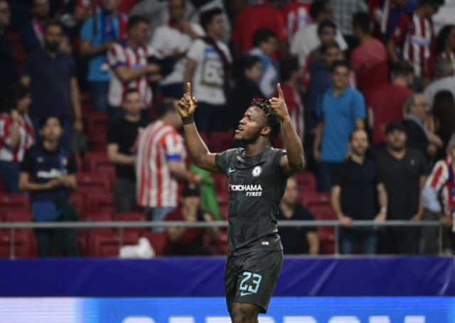Chelsea's striker Michy Batshuayi celebrates after scoring during the UEFA Champions League Group C football match Club Atletico de Madrid vs Chelsea FC at the Metropolitan stadium in Madrid on September 27, 2017