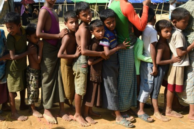 Children lining up for relief supplies at the Kutupalong refugee camp for Rohingyas who have fled to Bangladesh to escape violence in Myanmar