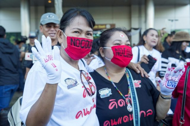 "As former prime minister Yingluck Shinawatra's lawyers arrived at the Bangkok court, several hundred supporters gathered outside chanted ""we love"" Yingluck, followed by ""Dubai!"""