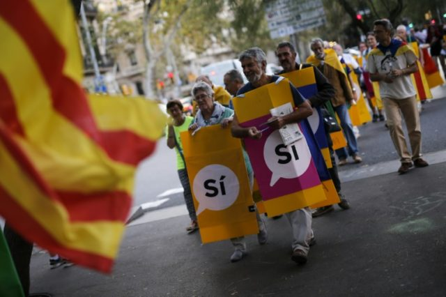 Though members of the Catalan National Assembly joined a pro-independence march in Barcelona, some voters who want to stay a part of Spain believe they are the silent majority
