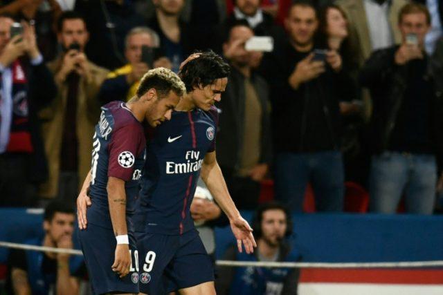 Paris Saint-Germain's forward Neymar (L) and Paris Saint-Germain's forward Edinson Cavani react during the UEFA Champions League match between Paris Saint-Germain and Bayern Munich on September 27, 2017 at the Parc des Princes stadium in Paris