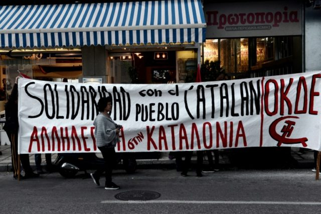 Members of far left parties demonstrate outside of the Spanish Consulate, in Thessaloniki on September 28, 2017, as they protest against the measurements take from Spanish government three days before the referendum on independence of Catalonia