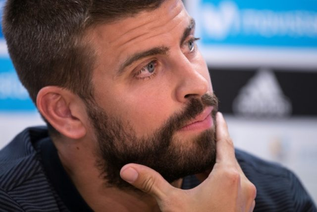 """From today until Sunday, we will express ourselves peacefully,"" Barcelona defender Gerard Pique posted in a message in Catalan on his Twitter account"
