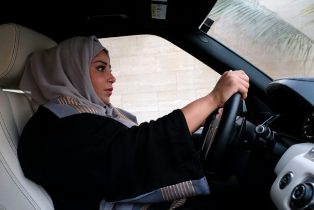 A Saudi woman drives her car in Jeddah on September 27, 2017