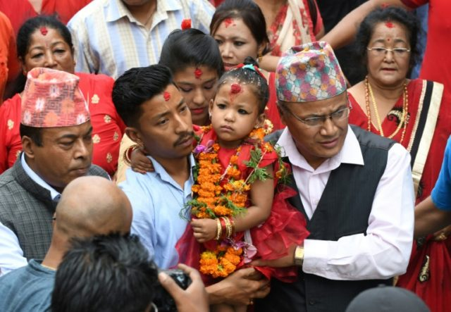 As the Kumari, three-year-old Trishna Shakya is considered the embodiment of the Hindu goddess Taleju and will only be allowed to leave the temple 13 times a year on special feast days