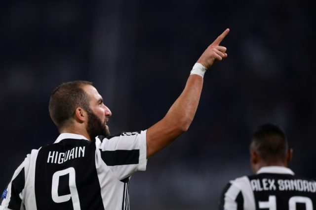 Juventus forward Gonzalo Higuain celebrates scoring during the Champions League Group D match against Olympiacos at the Juventus stadium in Turin on September 27, 2017