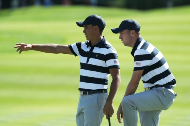 Rickie Fowler (L) and Justin Thomas of the US Team talk on the eighth green during the Presidents Cup in New Jersey