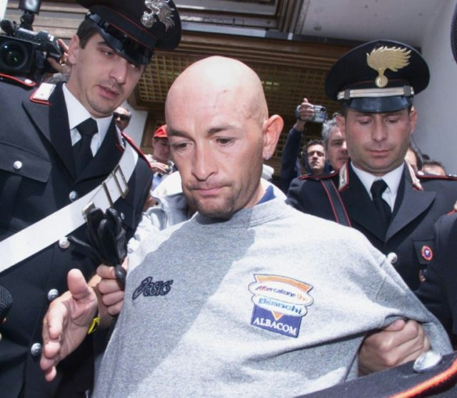 Italian cyclist Marco Pantani is escorted by Italian Carabinieri, after his exclusion from the 82nd Tour of Italy cycling race after failing a blood test on June 5, 1999