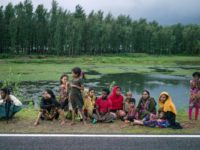 Rohingya Muslim refugees wait on a road in Bangladesh's Ukhia district on September 28, 2017. The UN is to extend a fact-finding mission into abuses committed against the minority in Myanmar