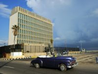 A vintage car drives by the US Embassy in Havana, which Secretary of State Rex Tillerson has said could be closed over mysterious attacks on American diplomats