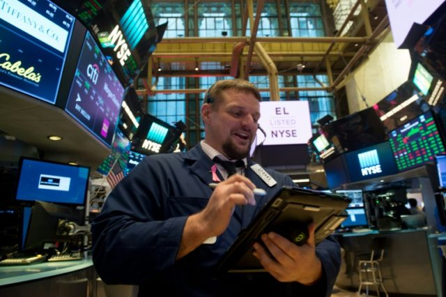 Investors are in wait-and-see mode as they head into the weekend, traders said.