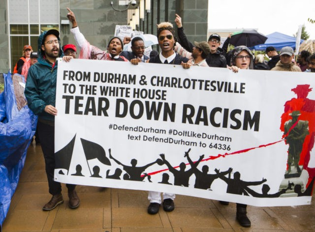 Protesters begin to march at the Durham County jail toward the site of the toppled Confederate monument on Main St., Tuesday, Sept. 12, 2017, in Durham, N.C, after a court hearing for several activists who were charged in toppling the monument. The protest was organized for a national week of action because Sept. 12 is also the one-month anniversary of the murder of anti-fascist protester Heather Heyer in Charlottesville, Va. (Casey Toth/The Herald-Sun via AP)