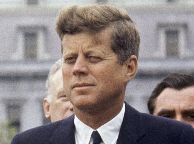 FILE - In this April 30, 1963 file photo, President John F. Kennedy listens while Grand Duchess Charlotte of Luxembourg speaks outside the White House in Washington. The National Archives has until Oct. 26, 2017, to disclose the remaining files related to Kennedy's Nov. 22, 1963 assassination, unless President Donald …