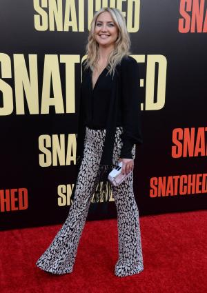 Kate Hudson returns to red carpet after shaving head
