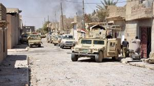 Dozens of Islamic State militants uncovered in mass grave in Iraq