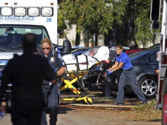 Ambulance worker evacuates elderly patient from Florida nursing home. (AP Photo/Beth Bennett)