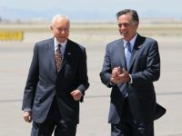 FILE - In this June 8, 2012 file photo, Republican presidential candidate, former Massachusetts Gov. Mitt Romney, right, laughs walking side-by-side with Sen. Orrin Hatch, R-Utah, who met him on the tarmac at Salt Lake International Airport, in Salt Lake City. Local television stations recorded the moment, reminding the state's …