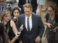 Sen. Jeff Flake, R-Ariz., and other senators arrive for weekly policy meetings on Capitol Hill in Washington, Tuesday, July 11, 2017. With at least a dozen Republicans opposing or challenging parts of the GOP health care bill, Senate Majority Leader Mitch McConnell, R-Ky., said he will unveil their revised health …