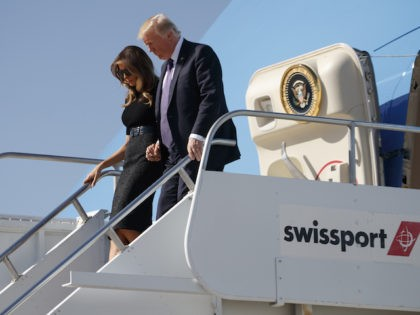 President Donald Trump and first lady Melania Trump arrive at Las Vegas McCarran International airport to meet with victims and first responders of the mass shooting, Wednesday, Oct. 4, 2017, in Las Vegas. (AP Photo/Evan Vucci)