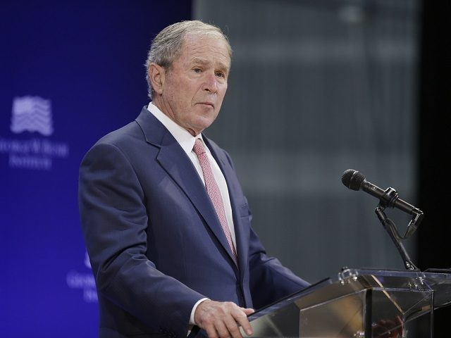 Bush condemns bigotry, Russian interference