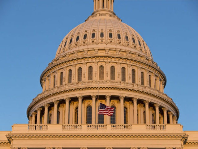 The American flag flies at half-staff over the U.S. Capitol at sunset following the shooting at the Washington Navy Yard, Monday, Sept. 16, 2013, in Washington. President Barack Obama ordered flags on federal property to be flown at half-staff through Friday. (AP Photo/J. Scott Applewhite)