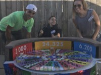 Anthony Alfano, 8, of Melrose Park, Illinois, is turning heads after his parents fashioned a Wheel of Fortune Halloween costume out of his wheelchair.