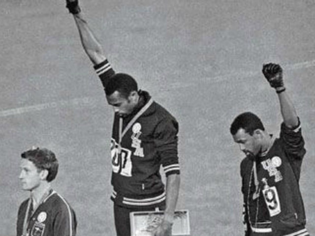 John Carlos (on right), Tommie Smith (centre) and Peter Norman, who wore an Olympic Project for Human Rights badge in support of their gesture. When Norman died in 2006, Carlos and Smith were pallbearers at his funeral. Photograph: AP