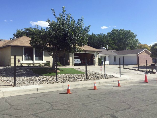 "The house used in the AMC-TV series ""Breaking Bad"" with poles for a new fence is shown in this Friday, Oct. 13, 2017 photo in Albuquerque, N.M. Photo Credit: AP"