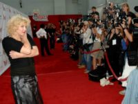 Courtney Love poses for photographers on the red carpet of a 2005 Comedy Central roast of Pamela Anderson.