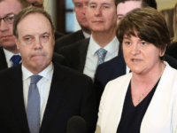 Democratic Unionist Party (DUP) leader, and former Northern Ireland First Minister, Arlene Foster (R) and DUP Deputy Leader Nigel Dodds address the media inside Parliament Buildings, the seat of the Northern Ireland Assembly, on the Stormont Estate in Belfast, Northern Ireland, on March 27, 2017. Britain is aiming for an …