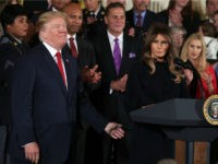 U.S. first lady Melania Trump (R) speaks as President Donald Trump (L) and other attendees listen during an event highlighting the opioid crisis in the U.S. October 26, 2017 in the East Room of the White House in Washington, DC. Trump plans to authorize the Department of Health and Human Services to declare a nationwide public health emergency in an effort to reduce the number of opioid overdose deaths across the nation. (Photo by Alex Wong/Getty Images)