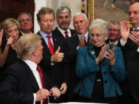 WASHINGTON, DC - OCTOBER 12: U.S. Sen. Rand Paul (R-KY) shows a thumbs up to President Donald Trump during an executive order signing as Vice President Mike Pence, Rep. Virginia Foxx (R-NC) and Secretary of Labor Alexander Acosta look on during an event in the Roosevelt Room of the White …