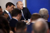 White House chief economic adviser Gary Cohn listens as White House press secretary Sarah Huckabee Sanders speaks during the daily press briefing, Thursday, Sept. 28, 2017, in Washington. (AP Photo/Evan Vucci)
