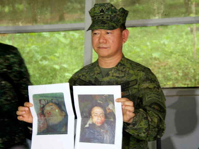 In this photo released by the 4th Civil Relations Group, Civil Relations Service Armed Forces of the Philippines, Philippine military chief Gen. Eduardo Ano holds pictures of dead militant leaders during a press conference at a military camp in Marawi, southern Philippines on Monday, Oct. 16, 2017. The last two …