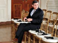 Gen. Mike Flynn sits alone Carolyn KasterAP