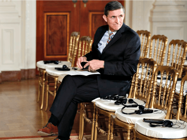Gen. Mike Flynn sits alone Carolyn KasterAP
