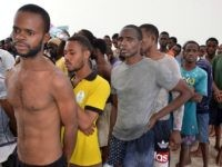 Migrants arrive at the El-Kitif port in the Tunisian town of Ben Guerdane, some 40 kilometres west of the Libyan border, following their rescue by Tunisia's coastguard and navy after their vessel overturned off Libya, on August 23, 2015. 125 migrants, including 28 women, were rescued from two boats which broke down as they headed from Libya to Italy, an AFP photographer said. AFP PHOTO / FETHI NASRI (Photo credit should read FETHI NASRI/AFP/Getty Images)