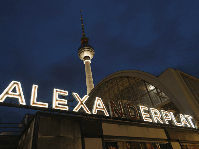 BERLIN, GERMANY - JULY 13: The broadcast tower at Alexanderplatz stands behind an illuminated sign at the Alexanderplatz train station on July 13, 2016 in Berlin, Germany. Alexanderplatz and the tower are among the most famous landmarks of the city. (Photo by Sean Gallup/Getty Images)
