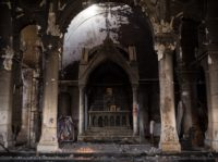 QARAQOSH, IRAQ - NOVEMBER 08: The burnt and destroyed interior of the St Mary al-Tahira church is seen on November 8, 2016 in Qaraqosh, Iraq. The NPU is a military organization made up of Assyrian Christians and was formed in late 2014 to defend against ISIL. Qaraqosh, a largely Assyrian …