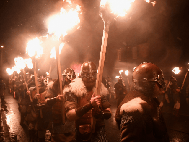 LERWICK, SCOTLAND - JANUARY 31: The Jarl squad begin to light torches at the culmination of Up Hell Aa on January 31, 2017 in Lerwick, Shetland. The traditional festival of fire, known as Up Helly Aa, takes place annually on the last Tuesday of January. The climax of the day …