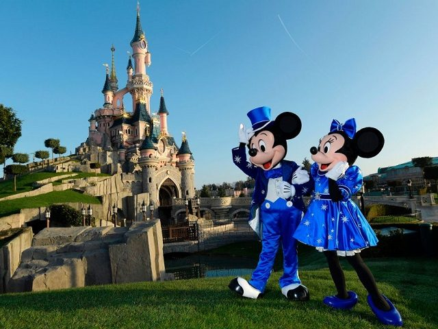 Disney characters Mickey and Mini mouse pose in front of the Sleeping Beauty Castle to mark the 25th anniversary of Disneyland - originally Euro Disney Resort - on March 16, 2017 in Marne-La-Vallee, east of the French capital Paris. The 25th anniversary celebrations will begin on March 26, 2017 with parades, various shows and a firework's display. / AFP PHOTO / BERTRAND GUAY (Photo credit should read BERTRAND GUAY/AFP/Getty Images)