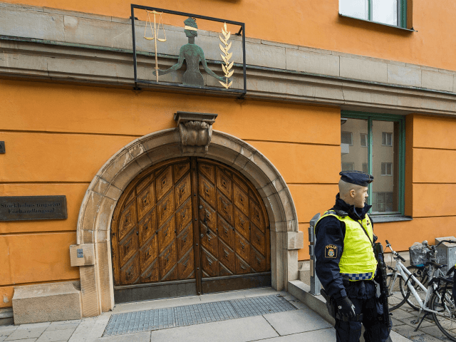 Policemen secure the entrance to the Stockholm District Court where Uzbek national Rakhmat Akilov (not in picture), prime suspect in the Stockholm truck attack, appeared in court on April 11, 2017. 39-year-old Uzbek national Akilov suspected of mowing down a crowd of people on a busy Stockholm street in a …