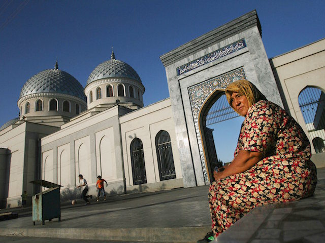 TASHKENT, UZBEKISTAN - AUGUST 16: (ISRAEL OUT) An Uzbek woman outside the Juma Mosque on August 16, 2006 in Tashkent in the central Asian country of Uzbekistan. Fifteen years after the breakup of the former USSR, the millions of Muslims living between the Caspian Sea and China, who for decades found themselves repressed under Communism, are experiencing a religious revival as neighboring regional powers Iran and Saudi Arabia strive to exert their influence on the vast region. Following the August 1991 abortive coup attempt in Moscow and the subsequent dissolution of the Soviet Union, Uzbekistan declared independence on August 31, 1991. (Photo by Uriel Sinai/Getty Images)