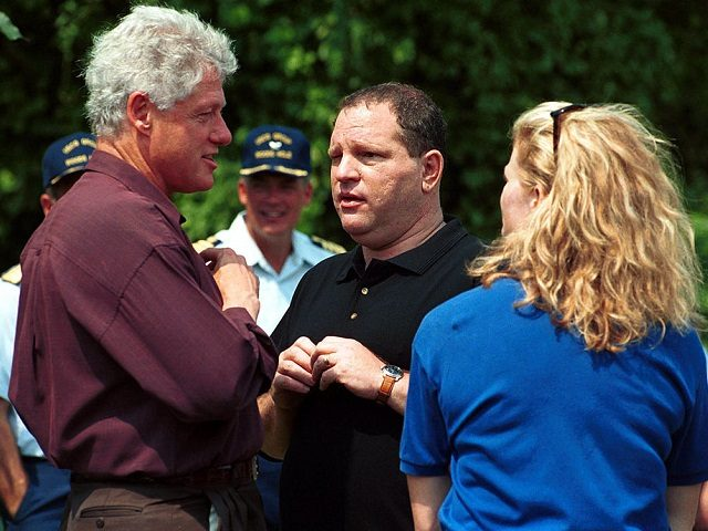 U.S. President Bill Clinton chats with movie executive Harvey Weinstein at the U.S. Coast Guard Station West Chop in Martha's Vineyard, MA August 7, 2000. Clinton ended a four day working vacation which included a party at the home of Weinsteins. (Photo by Darren McCollester/Newsmakers)