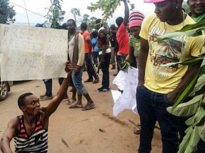 A demonstrator carries a sign calling for the liberation of detained activists during a protest against perceived discrimination in favour of the country's francophone majority on September 22, 2017 in Bamenda, the main town in northwest Cameroon and an anglophone hub. Several thousand demonstrators took to the streets in English-speaking …