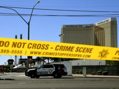 Crime scene tape surrounds the Mandalay Hotel (background with shooters window damage top right) after a gunman killed at least 58 people and wounded more than 500 others when he opened fire on a country music concert in Las Vegas, Nevada on October 2, 2017. Police said the gunman, a …