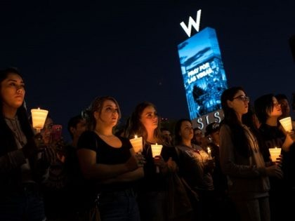 LAS VEGAS, NV - OCTOBER 2: Mourners attend a candlelight vigil at the corner of Sahara Avenue and Las Vegas Boulevard for the victims of Sunday night's mass shooting, October 2, 2017 in Las Vegas, Nevada. Late Sunday night, a lone gunman killed more than 50 people and injured more …