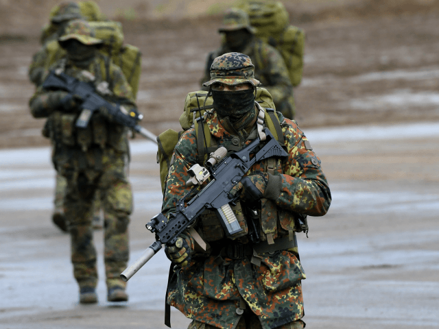 Soldiers of a ranger unit of the German armed forces Bundeswehr explore an area during the informative educational practice 'Land Operation Exercise 2017' at the military training area in Munster, northern Germany, on October 13, 2017. / AFP PHOTO / PATRIK STOLLARZ (Photo credit should read PATRIK STOLLARZ/AFP/Getty Images)