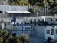 This photograph taken on October 13, 2017, shows an official government refugee shelter on the Greek island of Samos. Nearly 300 Syrians, Iraqis, Afghans and Africans from various countries live in this improvised camp located on a hill planted with olive trees, on this idyllic Greek island. They have arrived …